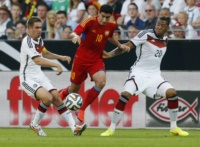 Germany's Philipp Lahm, left, and Jerome Boateng and Armenia's Gevorg Chazaryan control the ball during a soccer friendly match between Germany and Armenia in the Coface Arena in Mainz, Germany, Friday, June 6, 2014.