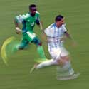 Argentina's Di Maria and Nigeria's Onazi run for the ball during their 2014 World Cup Group F soccer match at the Beira Rio stadium in Porto Alegre
