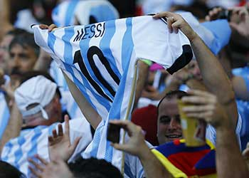 Fans of Argentina celebrate holding a jersey of Messi during their 2014 World Cup Group F soccer match against Iran at the Mineirao stadium in Belo Horizonte